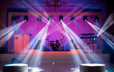 live band equipment setup with moving head lighting